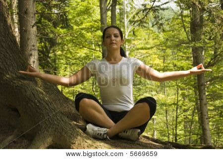 Woman Doing In Forest At Mountain