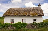 stock photo of quaint  - a quaint Irish Cottage with a traditional thatched roof - JPG