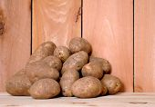 stock photo of solanum tuberosum  - many fresh russet potato in market place - JPG