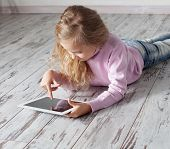 picture of floor heating  - Child with tablet lying on floor - JPG