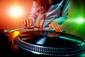 pic of mixer  - Dj hands on equipment deck and mixer with vinyl record at party - JPG
