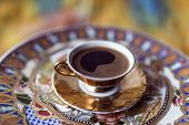 picture of coffee grounds  - Turkish greek coffee is a method of preparing coffee. Roasted and then finely ground coffee beans are boiled in a pot (cezve)
