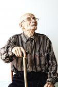 Senior Man In Eyeglasses Looking Up