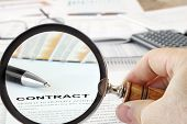 "stock photo of ballpoint  - Magnifying Glass Over  Papers and Word ""Contract""in Focus