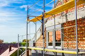 stock photo of scaffolding  - Empty workplace on scaffolding at big house - JPG