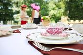 picture of table manners  - Tea cup and place setting at a tea party - JPG
