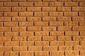 stock photo of tile cladding  - grungy rough brown colored sandstone cladding wall - JPG