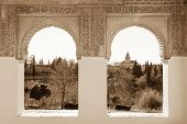 stock photo of harem  - Arches of Generalife palace in Alhambra with garden view - JPG