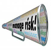 stock photo of financial audit  - Manage Risk words on a bullhorn and megaphone along with words of advice for loss prevention - JPG