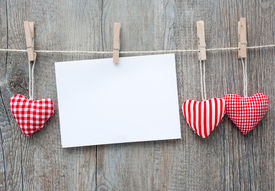 picture of clotheslines  - Message and red hearts on the clothesline against wooden background - JPG
