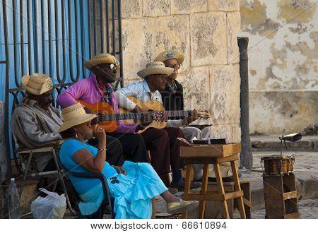 HAVANA, CUBA - JANUARY 30, 2011: Street musicians in Plaza de la Catedral San Cristobal, in Old Havana built between 1748 and 1777.
