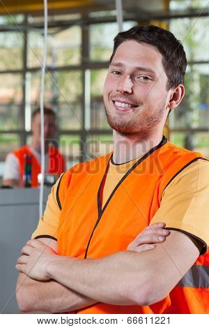 Portrait Of A Worker In Orange Protective Vest