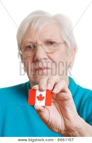Senior Woman Holding Canada Day Flag Focus On