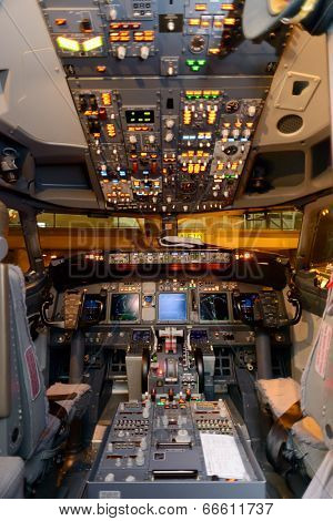 HONG KONG, CHINA - MAY 12, 2014: Malaysian Airline Boeing 737 cockpit interior on MAY 12, 2014. Malaysian Airline System is the flag carrier airline of Malaysia