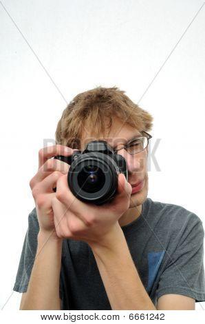 Young Teenage Boy Holding Digital Slr Camera