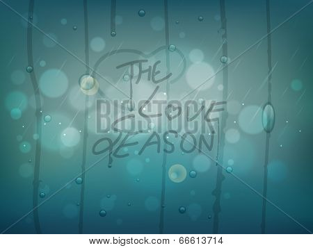 The Love Season written on a glass with raindrops denoted to season of Love, Monsoon.