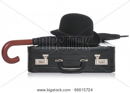 Black leather briefcase with bowler hat and umbrella, isolated on a white background.