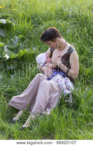Woman Breastfeeds A Baby