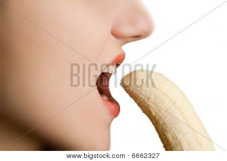 Girl Biting A Banana