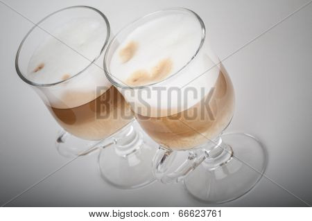 Two Glasses With Handles Of Latte Coffee On Gray Background