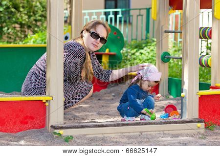 Mother And Daughter At Playground
