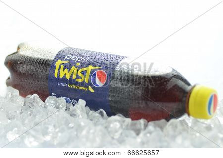 Bottle of Pepsi Twist drink on ice cubes