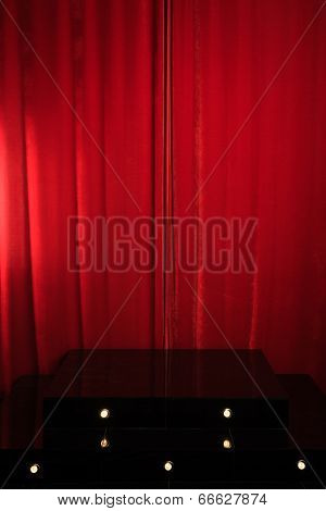 Red Podium On A Background Of Red Drape Curtains