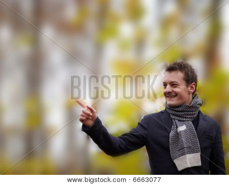 Trendy Young Man Pointing Up At Room To Copy