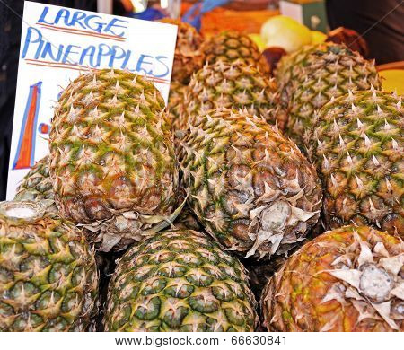 Large pineapples at market.