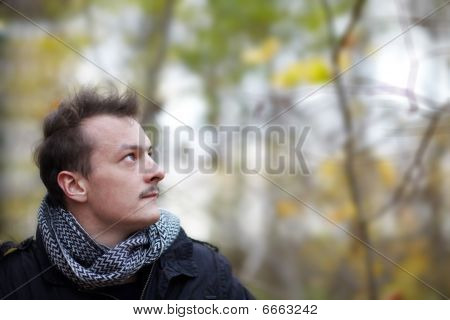 Trendy Young Guy Looking At Copyspace