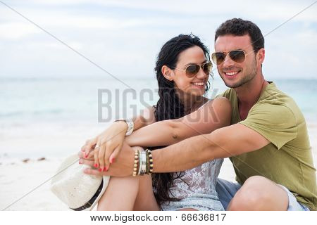 Young couple sharing a romantic moment at the beach