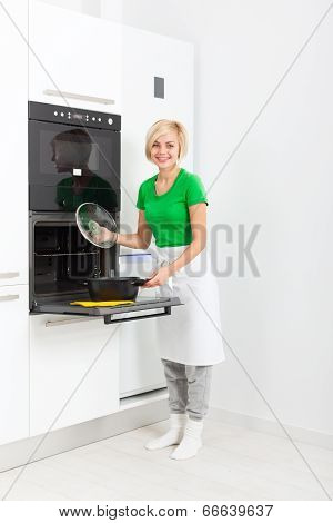 woman smile cook meal at home kitchen