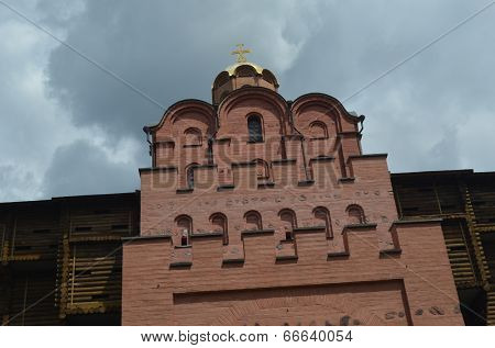 KIEV, UKRAINE -JUN 13, 2014: Golden Gate. Kiev. The tower restored with fragment of ancient masonry under fortified medieval gate .June 13, 2014 Kiev, Ukraine