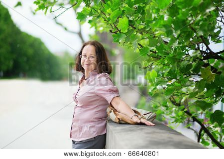 Happy Middle Aged Woman Enjoying Summer Day