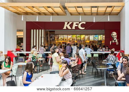 People Eating At Local Kentucky Fried Chicken Restaurant