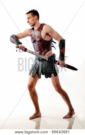 Spartan warrior / gladiator with sword preparing to battle on white background