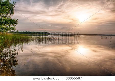 Beautiful vivid sunset over the lake Kanieris, Latvia. HDR