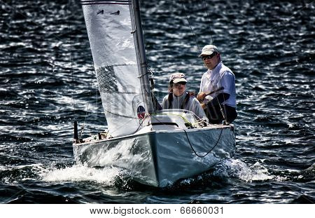 Man and woman sailing on Sydney Harbour