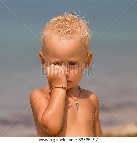 Offended Child On The Beach