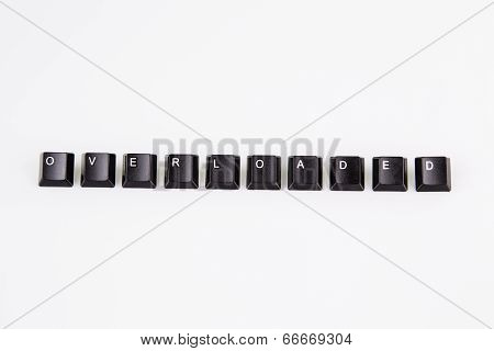 Overloaded Word Written With Black Computer Buttons Over White