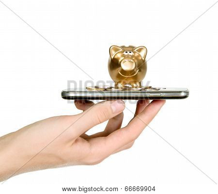 Golden Piggy Bank On Top Of Mobile Phone Screen