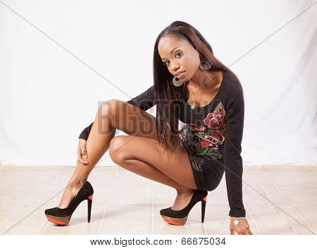 Black woman squatting