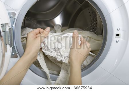 Delicate Wash, Woman Taking Delicate Laundry (underwear) From Washing Machine