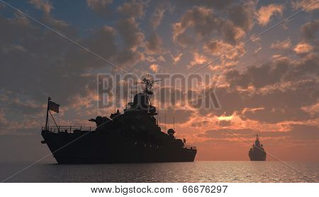 Military ship in the sea at sunset.