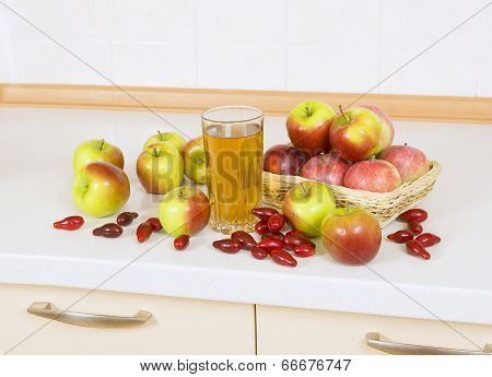 Apple Juice With Apples And Cornelian Cherry On The Table
