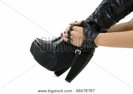 Female Foot In Stylish Black Leather Boots