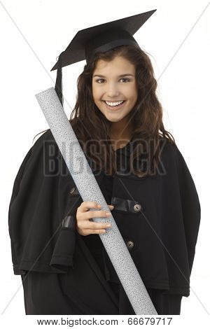 Portrait of happy young female graduate in academic dress holding diploma.