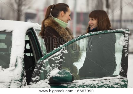 Two Women Talking In Winter