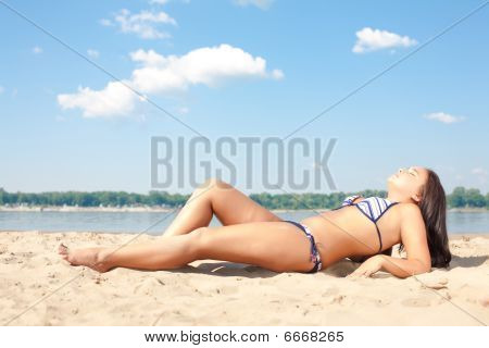 Beautiful Young Asian Girl In A Bikini On A Beach At Midday