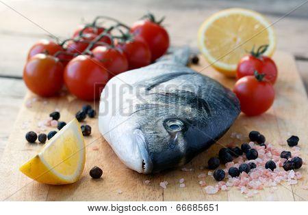 Fresh Dorado Fish On Cutting Board